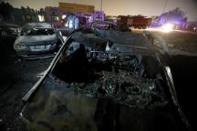 Burned vehicles are seen following a fire that broke out in Egypt\u0027s Shuqair-Mostorod crude oil pipeline, at the beginning of Cairo-Ismailia road, Egypt