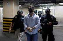 Luis Enrique, one of the sons of former Panamanian President Ricardo Martinelli, is escorted by police officers after being detained along with his brother Ricardo to face extradition to the U.S. on money laundering charges, in Guatemala City, Guatemala.