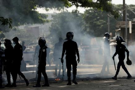 Policemen are seen during a protest against president Alassane Ouattara's decision to stand for a third term, in Abidjan, Ivory Coast.